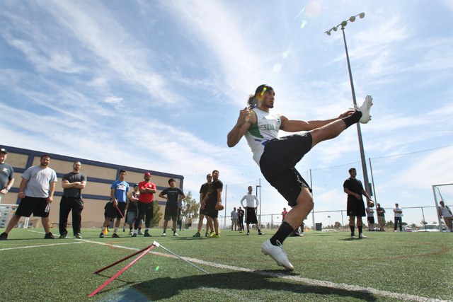 Ali Mourtada follows through on a field goal kick during an open tryout for the kicker position with the Las Vegas Outlaws Saturday, March 21, 2015. (Sam Morris/Las Vegas Review-Journal)