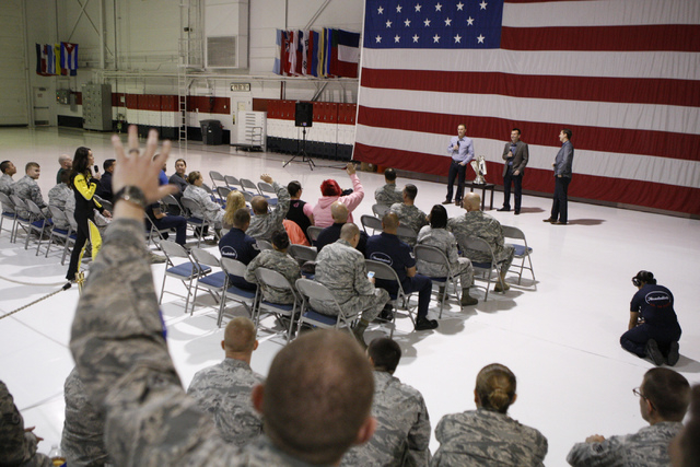 Spectators listen to NASCAR driver Kevin Harvick speak during a visit to Nellis Air Force Base in Las Vegas Tuesday, Dec. 2, 2014. NASCAR driver Kevin Harvick participated in the event for Nellis  ...