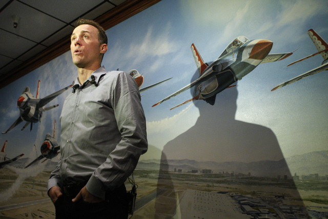 NASCAR driver Kevin Harvick is interviewed during a visit to Nellis Air Force Base in Las Vegas Tuesday, Dec. 2, 2014. Harvick, winner of the 2014 NASCAR Sprint Cup Series, displayed his trophy du ...