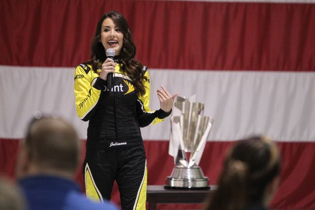 Miss Sprint Cup Julianna White speaks during a presentation at the Nellis Air Force Base in Las Vegas Tuesday, Dec. 2, 2014. NASCAR driver Kevin Harvick participated in the event for Nellis Air Fo ...