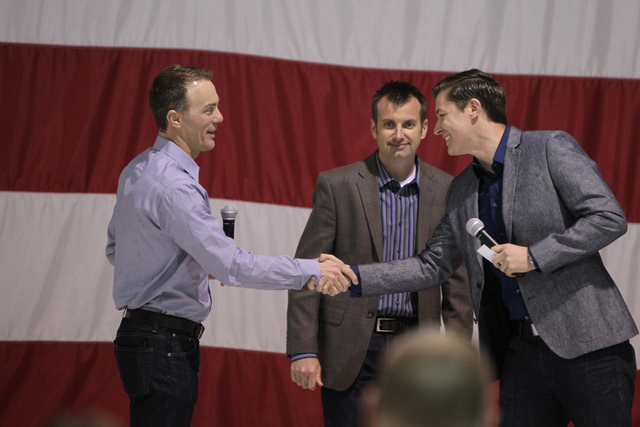 NASCAR driver Kevin Harvick, from left, crew chief Rodney Childers, and reporter Alan Cavanna, participate during a presentation for airmen and family members at Nellis Air Force Base in Las Vegas ...