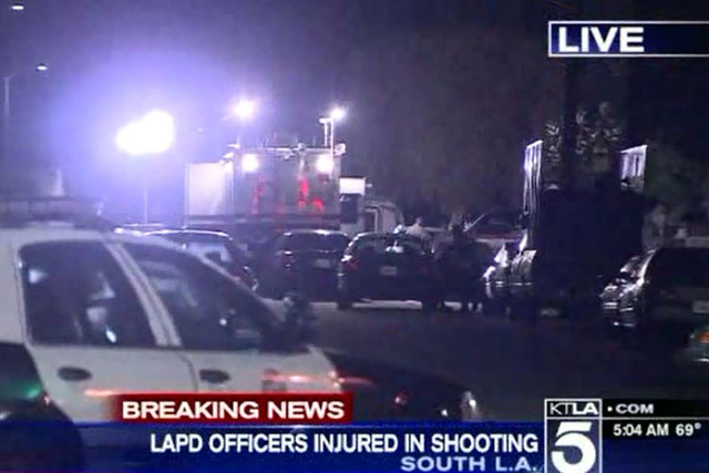 Three people have been detained in connection with a shooting that left two Los Angeles police officers with minor injuries on Sunday, March 15, 2015. (Screengrab/KTLA)