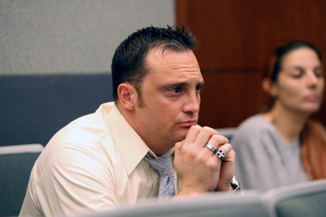 Former Henderson police officer, Joseph Lawrance, who plead guilty in a DUI case, awaits sentencing in the courtroom of Judge Carolyn Ellsworth on Wednesday, March 11, 2015. (Michael Quine/Las Veg ...