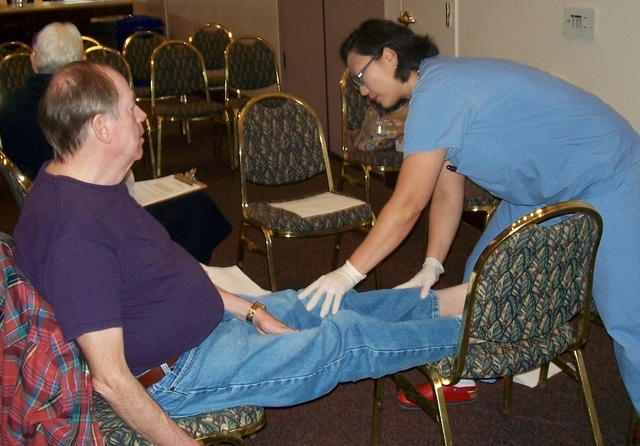 Dr. Eunah Hong, standing, tends to a Sun City Summerlin resident Feb. 12 during a diabetes screening. The event, Save Your Limbs and Maybe Your Life, included a talk given by Lions members Drs. La ...