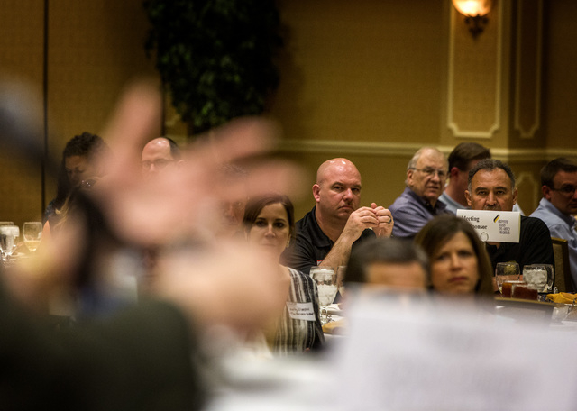 People listen while Mayor Carolyn Goodman gestures during a debate with Councilman Stavros Anthony debate at  Commercial Real Estate Development  Association  luncheon and mayoral debate at The Or ...