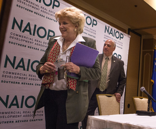 Mayor Carolyn Goodman,left, and Councilman Stavros Anthony  exit the stage after their mayoral debate at the Commercial Real Estate Development  Association luncheon at The Orleans,  4500 West Tro ...