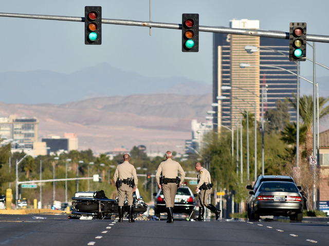 Las Vegas police investigate an accident that involved a police motorcycle at the intersection of West Desert Inn Road and Tenaya Way on Monday, March 9, 2015. (David Becker/Las Vegas Review-Journal)
