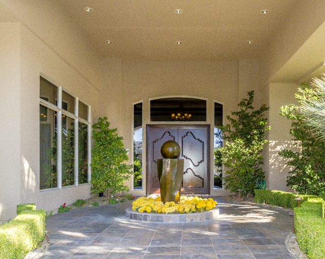A modern art fountain centers the front entrance.  (John Kelly/Las Vegas Review-Journal)