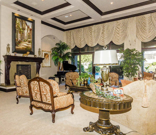 The rest of the great room features a grand piano and fireplace.  (John Kelly/Las Vegas Review-Journal)