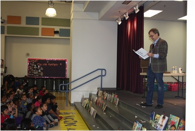 "Mac King reads an excerpt from ""The Book with No Pictures"" by B.J. Novak to the students at Hollingsworth Elementary School during Nevada Reading Week on March 3, 2015. Each student at the school  ..."