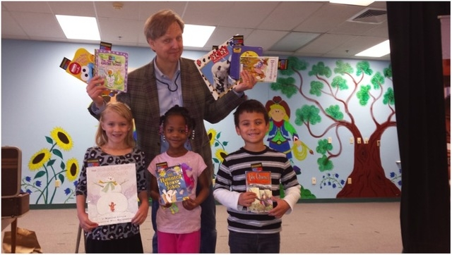 Mac King poses with students at Bunker Elementary School during Nevada Reading Week on March 4, 2015. Each student at the school was able to take a book home to keep courtesy of Mac King's Magic ...