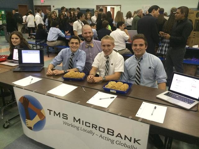 Members of the MicroBank Club at The Meadows School, 8601 Scholar Lane, are seen in fall 2014 during an Upper School Club Fair. From left are sophomore Michael Blau, faculty adviser Adam Betzel ...