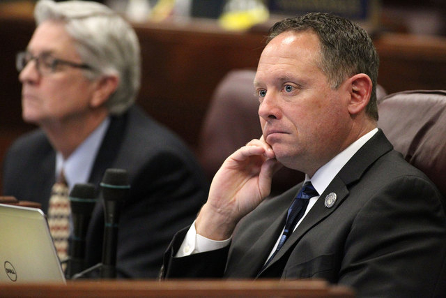 Assemblyman Mike Sprinkle, D-Sparks, works on the Assembly floor at the Legislative Building in Carson City on March 16, 2015. Sprinkle introduced a bill that would prohibit smoking in any vehicle ...