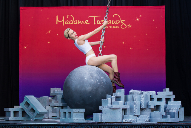 A wax figure of Miley Cyrus on top of a wrecking ball, created by Madame Tussauds' studio team, is unveiled outside of the Venetian hotel-casino in Las Vegas on Monday, March 9, 2015. (Chase Steve ...