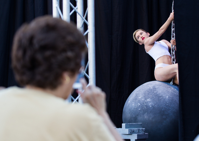 Susan Laczko of Pittsburgh takes a photo of a wax figure of Miley Cyrus on top of a wrecking ball, created by Madame Tussauds' studio team. (Chase Stevens/Las Vegas Review-Journal)