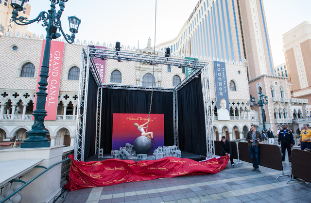 A wax figure of Miley Cyrus on top of a wrecking ball, created by Madame Tussauds' studio team, is unveiled outside of the Venetian hotel-casino in Las Vegas on Monday, March 9, 2015. The figure,  ...