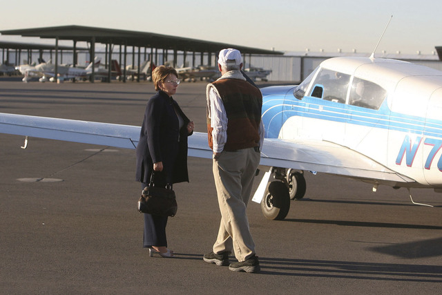 Founder of the Miracle Flights charity Ann McGee, left, talks with pilot Mike Kosby as they stand next to a private plane used for Miracle Flights at the North Las Vegas Airport, Thursday, Nov. 16 ...