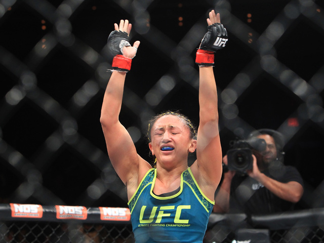 Carla Esparza reacts defeating Rose Namajunas to become the UFC's female strawweight champion on Dec. 12, 2014 at the Palms. Esparza defends her title against Joanna Jedrzejczyk on Saturday in UFC ...