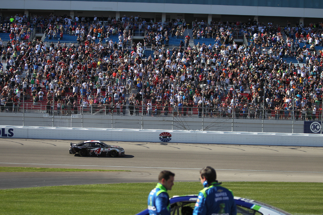 Kevin Harvick (4) drives around the track after performing a burn out in celebration of his win in the NASCAR Sprint Cup Series Kobalt 400, Sunday, March 8, 2015. (Erik Verduzco/Las Vegas Review-J ...
