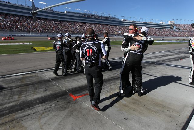 Pit crew members for Kevin Harvick (4) celebrate their win in the NASCAR Sprint Cup Series Kobalt 400, Sunday, March 8, 2015. (Erik Verduzco/Las Vegas Review-Journal)