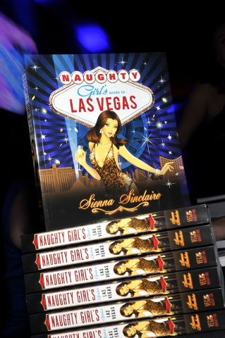 "Author, model and naughty lifestyle expert Sienna Sinclaire new book, ""Naughty Girl's Guide to Las Vegas,"" is on display at Sapphire Gentlemen's Club in Las Vegas on Friday, Feb. 20, 201 ..."
