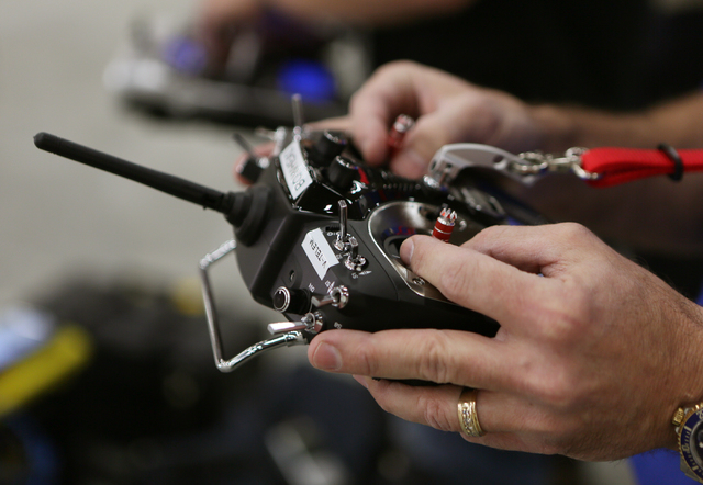 Bill Wilson controls the drone portion of an Unmanned Aerial Vehicle during a test run at South Point Wednesday, Feb. 25, 2015, in Las Vegas. The UAV, a custom-built platform that is owned and ope ...