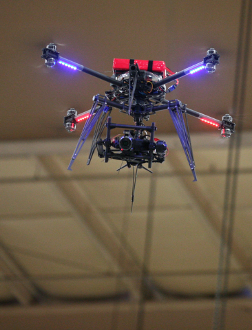 An Unmanned Aerial Vehicle that is made up of a drone and a gimbal camera flies through the air during a test run at South Point Wednesday, Feb. 25, 2015, in Las Vegas. The UAV, a custom-built pla ...