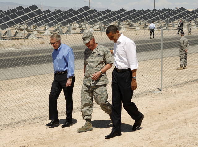 U.S. Senate Majority Leader Harry Reid, D-Nev., left, walks with, continuing from left, U.S. Air Force Col. Howard Belote and President Barack Obama, during a tour of the Nellis Air Force Base Sol ...