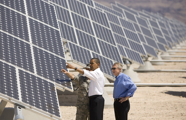 U.S. Air Force Col. Howard Belote, left, leads, continuing from left, President Barack Obama and U.S. Senate Majority Leader Harry Reid, D-Nev., on a tour of the Nellis Air Force Base Solar Power  ...