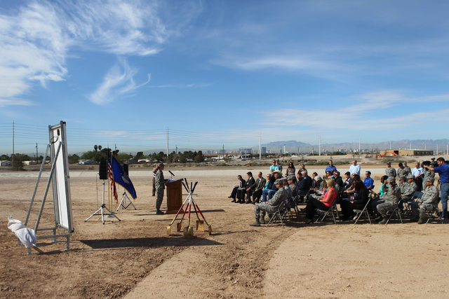 People participate during a ground breaking ceremony for the Nellis Solar Array II project at Nellis Air Force Base in Las Vegas Tuesday, March 24, 2015. The 15 megawatt panels designed by SunPowe ...