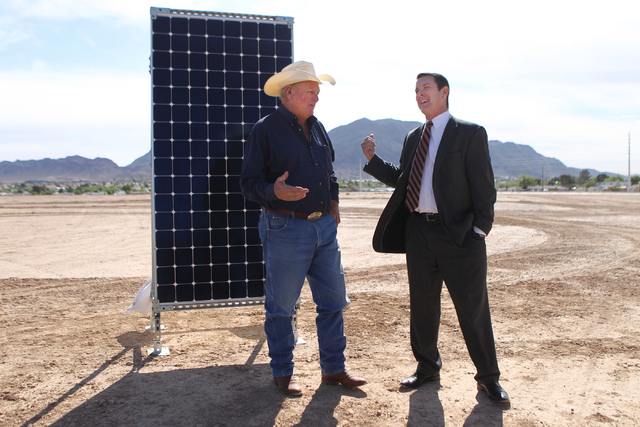 Clark County Commissioner Tom Collins, left, seaks with Patrick Egan, senior vice president for NV Energy, during a ground breaking ceremony for the Nellis Solar Array II project at Nellis Air For ...