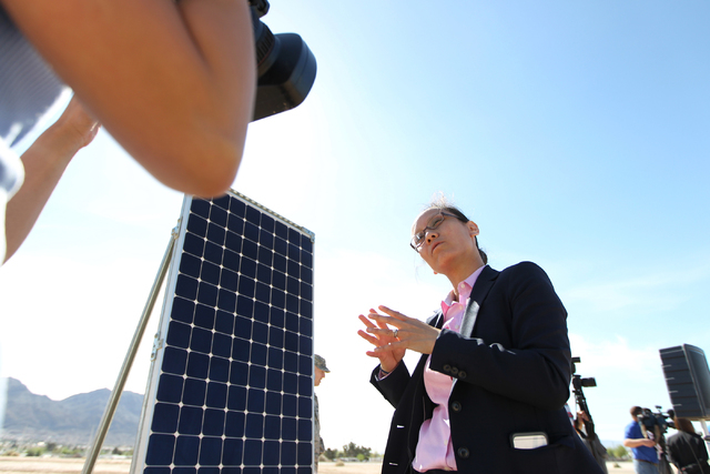 Nam Nguyen, vice president for Americas Power Plants at SunPower, is interviewed during a ground breaking ceremony for the Nellis Solar Array II project at Nellis Air Force Base in Las Vegas Tuesd ...