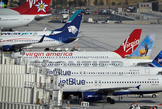 A Virgin America aircraft is parked along with other jets at McCarran International Airport's Terminal 3 before it departs on Monday, Jan. 12, 2015. (David Becker/Las Vegas Review-Journal)
