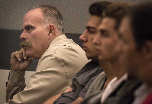 Robert Meyers, the husband of Tammy Meyers, watches while Erich Nowsch and Derrick Andrews make their appearance in Regional Justice Center on Thursday, March 26, 2015. The two are charged in the  ...