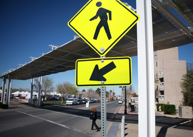 A pedestrian uses the crosswalk on Water Street as a news conference on pedestrian safety efforts concludes nearby Thursday, March 5, 2015, in Henderson. Regional Transportation Commission and Nev ...