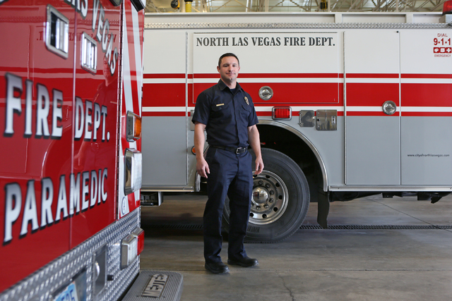 Firefighter Ryan Green stands outside a fire truck at North Las Vegas Fire Station 53 Tuesday, Jan. 20, 2015. Dr. Tim Tollestrup performed surgeries on Green, who sustained injuries when he was fi ...