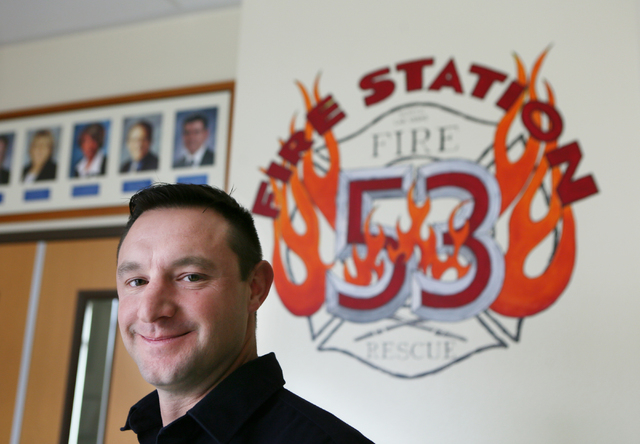 Firefighter Ryan Green stands near his fire station's seal in the lobby of North Las Vegas Fire Station 53 Tuesday, Jan. 20, 2015. Dr. Tim Tollestrup performed surgeries on Green, who sustained in ...