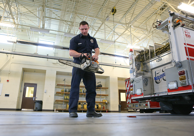 Firefighter Ryan Green performs an inspection on a chainsaw during his shift at North Las Vegas Fire Station 53 Tuesday, Jan. 20, 2015. Dr. Tim Tollestrup performed surgeries on Green, who sustain ...