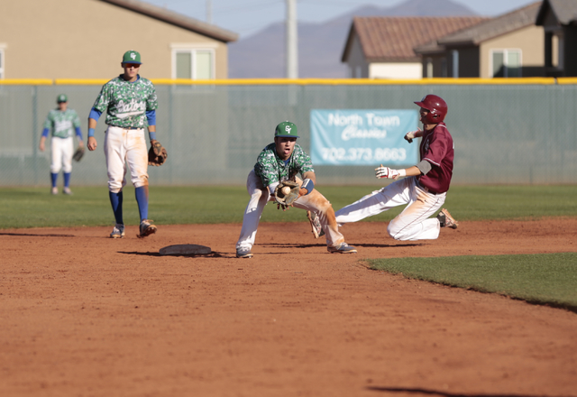 Green Valley High School Sophomore A.J. Amelburu (4) catches a throw to second but misses the tag towards Desert Oasis High School Sophomore Brett Brocoff (11)  during the Lions Kick Off baseball  ...