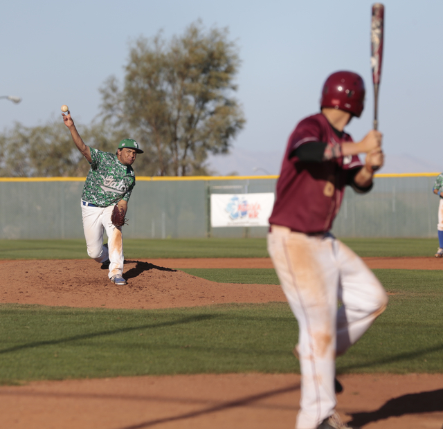 Green Valley High School pitcher,Junior Noah Wise (13) sends a ball towards the plate as Desert Oasis High School Senior Chase Adams (8) is ready to take a swing, during the Lions Kick Off basebal ...