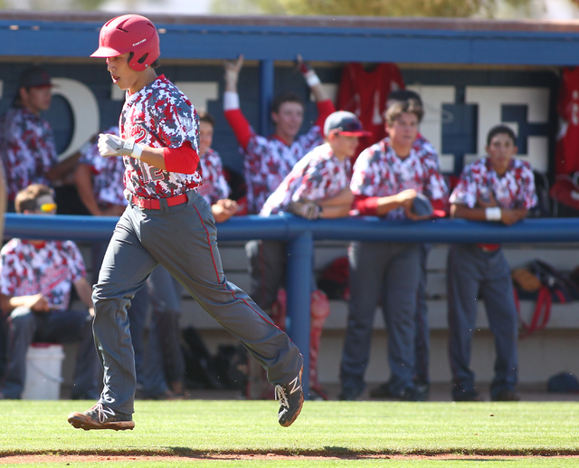 Arbor View's Nick Quintana (12) heads for home plate after his solo homer in the first inning against Sierra Vista on Thursday. The Aggies hit two home runs on the way to a 6-5 win. (Chase Stevens ...