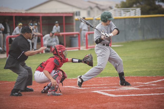 Rancho High School's Zach Barnhart (21) swings at a pitch during their baseball game played against Las Vegas High School from the Las Vegas High School on Wednesday March 11, 2015. (Martin S. Fue ...