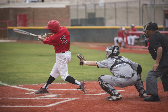 Las Vegas High School's Ryan Freimuth (6) swings at a pitch during their baseball game played against Rancho High School from the Las Vegas High School on Wednesday March 11, 2015. (Martin S. Fuen ...
