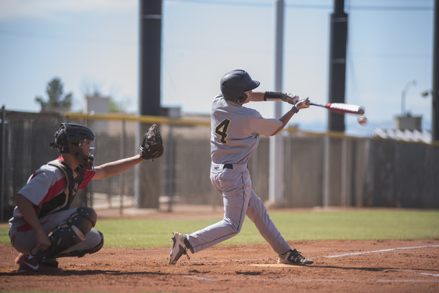 Boulder City's Michael Morelli (4) makes contact with the ball against Tech during their baseball game played at the Burkholder Park baseball field in Henderson, Nev., on Thursday March 26, 2015.  ...