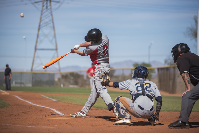 Tech's Trevor Kephart (2) makes contact with the ball against Boulder City during their baseball game played at the Burkholder Park baseball field in Henderson, Nev., on Thursday March 26, 2015. ( ...