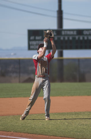 Tech's Trevor Kephart (2) catches the ball for an out against Boulder City during their baseball game played at the Burkholder Park baseball field in Henderson, Nev., on Thursday March 26, 2015. ( ...