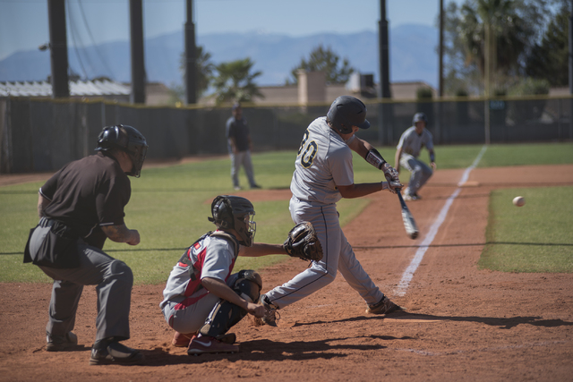 Boulder City's Preston Van Diest (30) swings at a pitch against Boulder City during their baseball game played at the Burkholder Park baseball field in Henderson, Nev., on Thursday March 26, 2015. ...