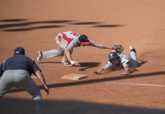 Boulder City's Nolan Desantis (1) is tagged out at third base by Tech's Trevor Kephart (2) during their baseball game played at the Burkholder Park baseball field in Henderson, Nev., on Thursday M ...