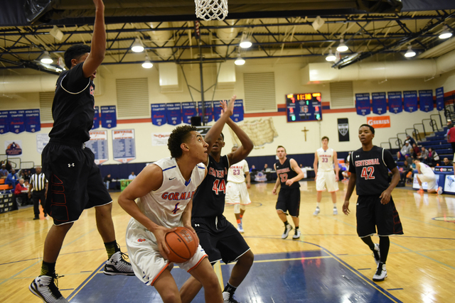 Bishop Gorman's Chase Jeter (4) shoots the ball over Corona Centennial's Ike Anigbogu (44) during the third-place game of the Tarkanian Classic on Saturday. Jeter had 16 points and 13 rebounds in  ...