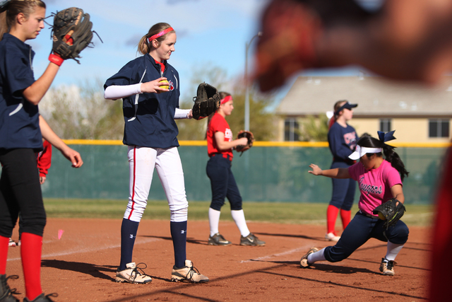 Sarah Pinkston, 16, second from left, pitcher for Coronado's varsity softball team, gets ready to throw the ball during a team practice at the Coronado High School softball field in Henderson, Nev ...